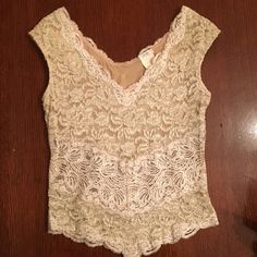 Lace top Spandex lace top with tan lining. Cache Tops Blouses