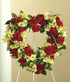Red roses, green orchids and Green Gladiolus in a Heart Standing Wreath