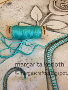 Lovely hand work from Margarita Korioth at Margarita Korioth: Quilting/ Mixed Media Artist, Paper + Fabric using Aurifil floss on http://margascrafts.blogspot.it/2015/01/working-with-aurifloss-8w-cotton.html