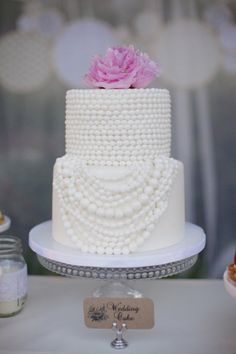 strands of pearls on wedding cake