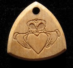 2015 February Member of the Month Etsy Maine Team Riff Wood Picks https://www.etsy.com/listing/213220496/celtic-claddagh-guitar-pick-necklace?ref=shop_home_active_3