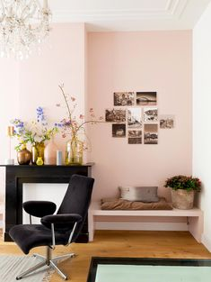 Small gallery wall in pastel pink living room