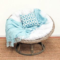 I don't care of they aren't considered chic, I love a papasan chair, and will have one again, with the ottoman, perhaps a ceramic garden stool as a side table, and a good light, all to make a perfect space for reading.