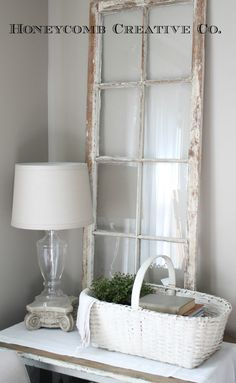 simple farmhouse style...I have a window exactly like this one.  Great idea :)