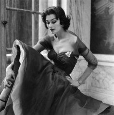 Ann Gunning for British Vogue. Gown by Dior. Norman Parkinson Photographer April 1952
