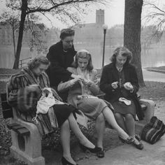 Members of Ballet Russe sitting in a park mending their dancing shoes and their tights, 1950s // Myron Davis