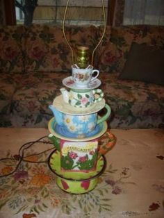 I used to collect teapots and got tired of them so I repurposed them into a teapot lamp. I used lamp parts from a $3.00 lamp I purchased to make it. Now I need to find the perfect lampshade!