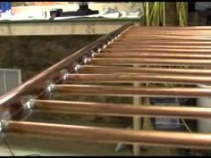 DIY Solar thermal water heater..................... You tube. FAR better description than most. Very well done and good looking design.  .................. Building a Water Heating Solar Panel.wmv - YouTube