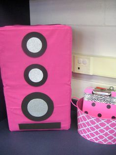 Storage Crate stereo speaks for Rock Star themed room . cover crates with fabric and glue on foam circles . you can store things in the back because the crates form shelves! (could be a cool station area)