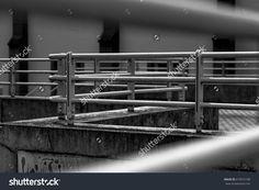 Through railings. Railings near a walkway.