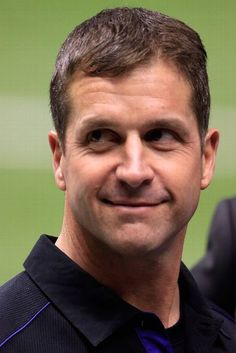 NEW ORLEANS, LA - FEBRUARY 03: Head coach John Harbaugh of the Baltimore Ravens smiles on the field during warm-ups prior to Super Bowl XLVII against the San Francisco 49ers at the Mercedes-Benz Superdome on February 3, 2013 in New Orleans, Louisiana.  (Photo by Jamie Squire/Getty Images)