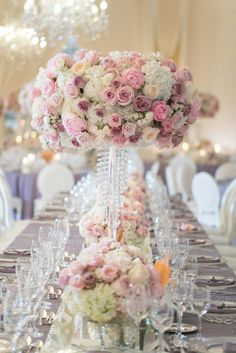 Centerpieces with lavender, pink and white blooms featuring garden roses, peonies, spray roses and hydrangea.