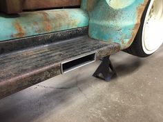 notched running board for exhaust tip.