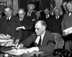 President Roosevelt Signing War Declaration Cabinet members watch with mixed emotions as President Franklin D. Roosevelt, wearing a black armband, signs the United States' declaration of war against Japan at 4:10 p.m. Washington time on December 8, 1941. On December 7, Japanese planes bombed Pearl Harbor, Hawaii in a surprise attack that destroyed a large portion of the fleet there, prompting the war declarationWhite House, Washington, DC, USA.December 08, 1941★★★★★★★★★★★★
