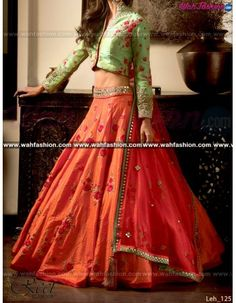 Look graceful and sophisticated at the upcoming wedding party by wearing this Reet Glamour Pista Green And Orange Embroidered Lehenga. Featuring an eye-catching design and pattern, this set will surely make you stand out from the crowd. Team this set with colourful bangles and a pair of trendy footwear to look ravishing. Made from Pure fabric to ensure optimum.  For more details whatsapp us on +919915178418