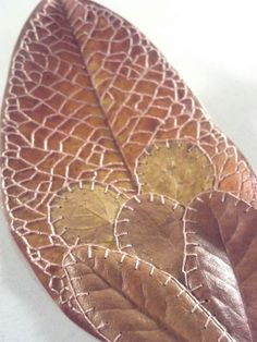 With this leaf I experimented with adding live oak leaves onto the magnolia leaf