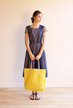 Lilith tulle dress, Jack Gomme bag both from France and GianLuca handmade sandal from Florence