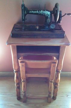Antique sewing machine on very  old telephone table...