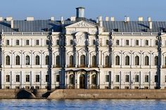 """Novo-Mikhailovskiy Palace. It is considered one of the greatest examples of architectural luxury in Petersburg. The palace is located on the so-called """"main street of palaces of St. Petersburg."""" The luxurious interiors are just as impressive as its facades. The walls of the Grand Duke's are decorated with panels of walnut wood, and there is a beautiful hand-carved walnut fireplace. There is a swimming pool in the green marble room. The main lobby has granite columns and a grand marble…"""