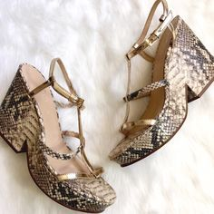 NWOT Kate Spade Snakeskin Platform Sandal Gorg! Metallic gold accents snakeskin material with a chunky mid-90s flashback heel. There's a small smudge to the front of the heel, very close to the sole and VERY hard to see! Also small black mark on one sole. kate spade Shoes Sandals