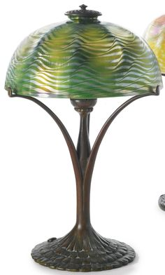 """TIFFANY STUDIOS  TABLE LAMP with a """"Ruffle"""" base  shade engraved L.C.T.  base impressed TIFFANY STUDIOS/NEW YORK/445  favrile glass and patinated bronze  16 1/8  in. (10.9 cm) high  9 7/8  in. (25.1 cm) diameter of shade  circa 1910"""