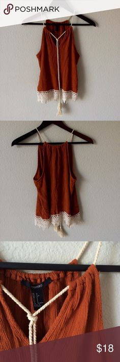 Forever 21 rust orange festival top Gorgeous rusty orange top from Forever 21. Festival boho vibes. Like new condition! Lace detailing around hemline. Adjustable rope top. Crimped pattern. Size small. Unsure of material because material tag is cutout but most likely a cotton, polyester, rayon blend. Forever 21 Tops Blouses