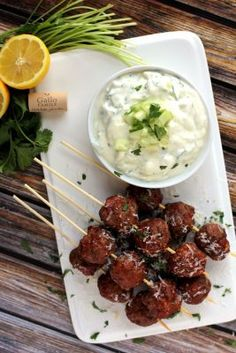 Spicy sausage meatballs spiked with Red Moscato wine, these Moscato Meatball Skewers are served alongside a cool yogurt sauce for a perfect appetizer or main course. New Year's Eve Appetizers, Yummy Appetizers, Appetizer Recipes, Wine Recipes, Great Recipes, Favorite Recipes, Meatball Recipes, Chicken Recipes, Spicy Sausage