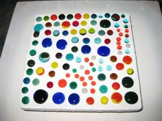 Begin by cutting strips of fusible glass:     You can use mosaic nippers to cut some strips into single layer squares for smaller globs.   S...