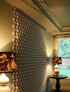 The scale of the tall lamps with their larger shades look right sitting next to the full height headboard
