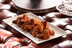 Tiffani Thiessen's Honey-Ginger Chicken Wings | COURTESY THE COOKING CHANNEL