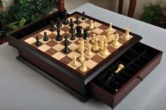 Hand Carved Wooden Chess Set – 34 ebony and boxwood weighted chessmen with cloth pads, walnut and maple storage chess board with a satin finish. This is an amazing value and a great addition to any game room.
