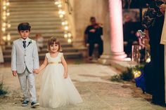Flower girl + ring bearer outfit idea - flower girl in tulle A-line dress with gold sash and ring bearer in light gray suit with matching blue necktie + shoes  {Kane and Social}