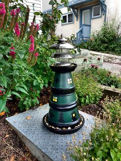 Summer Lighthouse Clay Pot. A fun project for anyone, and looks amazing in any garden or patio!