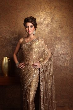 While I normally embrace bright colors when it comes to saris, this rich gold piece just exudes class.