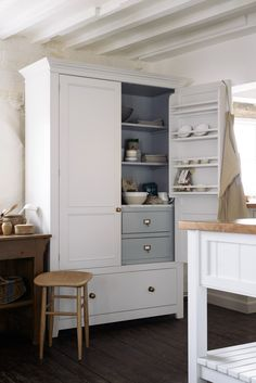 The Classic English Pantry Cupboard by deVOL; nothing surplus to requirements, just a beautifully made solid hardwood cupboard, with solid Oak drawers all on soft close drawer runners. A lovely slab of Carrara marble and some very traditional brass handles are the finishing touches.