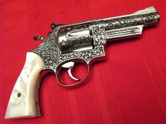 "badger-actual: "" Smith and Wesson Magnum, engraved by Ben Shostle. Smith And Wesson Revolvers, Smith N Wesson, Weapons Guns, Guns And Ammo, Colt Python, Colt 45, Cool Guns, Survival Prepping, Hand Engraving"
