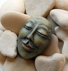 Face of Serenity, Face of Happiness paper clay over stone. could same effect be made with sculpting with hot glue? Paper Mache Clay, Clay Art, Clay Projects, Clay Crafts, Stone Crafts, Clay Dolls, Art Dolls, Paperclay, Air Dry Clay