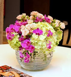Phalaenopsis orchids, spray roses, green hydrangea in a modern glass bowl.   $89.99