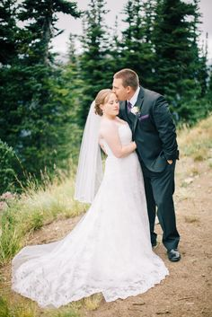 We love Crystal Mountain, and for Lindsey and Eric's Mountain wedding this summer, we found a new secret spot against the trees and captured this sweet smooch.  Photos by Clane Gessel Photography | #weddings #photography #brideandgroom #mountainweddings