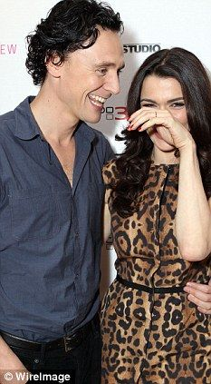 | Sea change: Tom Hiddleston and actress Rachel Weisz share a giggle ...love her