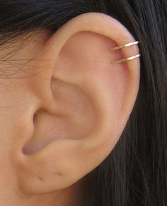 A wire-wrapped ear cuff with two wire loops. Ear cuff requires NO piercings. ($8.00)