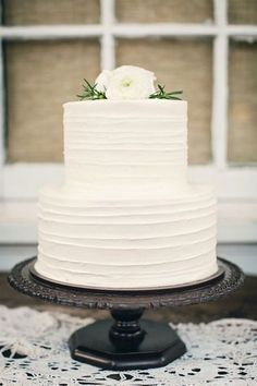 white wedding cake with white flowers on top / http://www.himisspuff.com/simple-elegant-all-white-wedding-color-ideas/2/