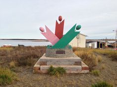 The Trans Canada Trail marker signifying the end of the line at Tuk
