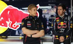 Heikki Huovinen Photos Photos - Sebastian Vettel (R) of Germany and Red Bull Racing talks with his trainer Heikki Huovinen as he prepares to drive during practice for the Chinese Formula One Grand Prix at the Shanghai International Circuit on April 13, 2012 in Shanghai, China. - F1 Grand Prix of China - Practice