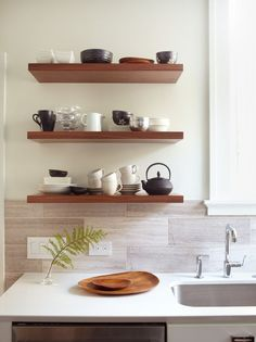 Simple wooden shelves that contrast with the white wall and that are great for storage