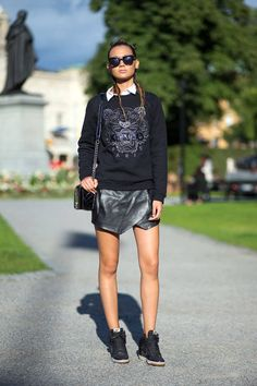 Leather skirt, Kenzo sweatshirt, kicks.