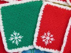 Woven Christmas coasters nne Rawlings DK acrylic for the squares, x-stitch with 4-ply cotton, and crochet edges with aran acrylic - just what I had to hand. The motifs look best done in a lighter weight to the squares and the edges looked a bit fuller with a heavier weight.