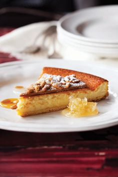 """Torta della Nonna, or """"grandmother's tart,"""" is traditionally a two-crusted tart filled with pastry cream that is seen in almost every trattoria in Italy."""