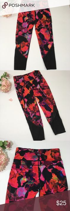 ATHLETA Floral Mesh Bottom Capri Workout Leggings Athleta capri leggings in excellent pre-owned condition. Pretty floral design with mesh accent at bottom section of leg. 88% polyester 12% Lycra spandex   Size Small Athleta Pants Leggings