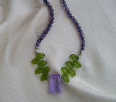 "Lilac glass pendant, green glass leaves, amethyst beads, silver plate beads. silver plate flower toggle. 17"" $55 SOLD"